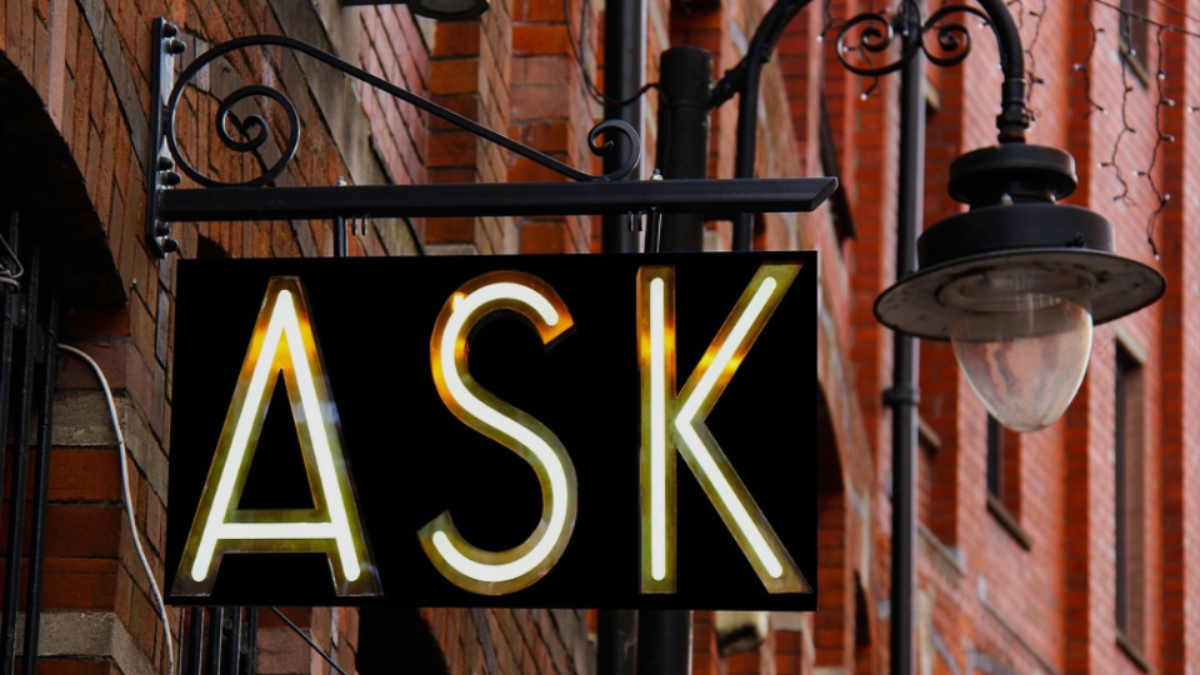 "A sign with the word ""ask"" on it."