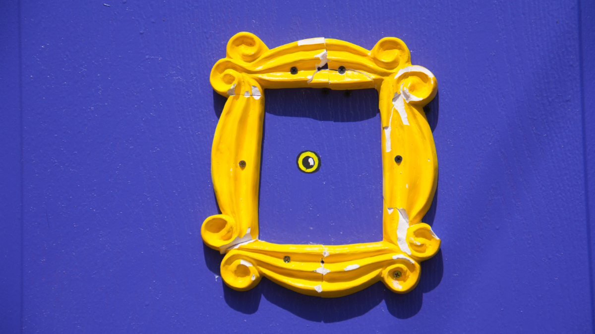 A yellow frame on a purple wall